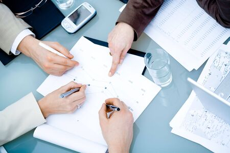 Close-up of hands of teamworking businesspeople on meeting at office. Stock Photo - 6347737