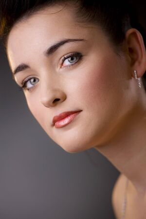 Closeup portrait of beautiful young woman with green eyes, make up for party. photo