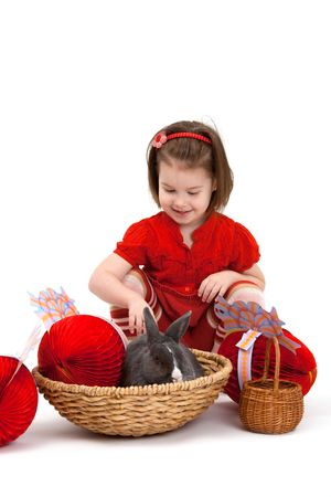 Easter image: smiling little girl with Easter bunny isolated on white background. Stock Photo - 6338538