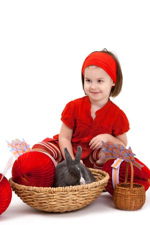 Easter image: smiling little girl with Easter bunny isolated on white background. Stock Photo - 6338533