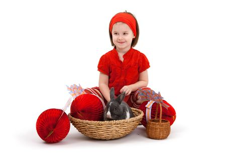 Easter image: smiling little girl with Easter bunny isolated on white background. photo