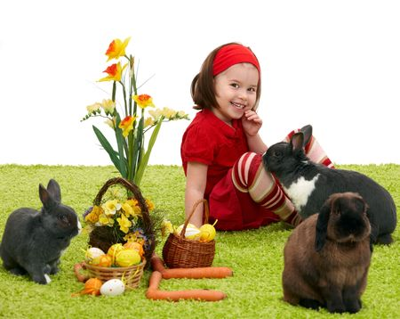 Easter image: smiling little girl with Easter bunny on green carpet. Stock Photo - 6338543