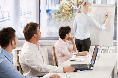 Business people listening to presentation at office. Stock Photo - 6373601