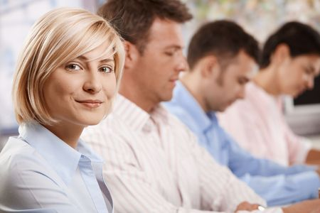 unsmiling: Happy businesswoman on business meeting, looking at camera and smiling.