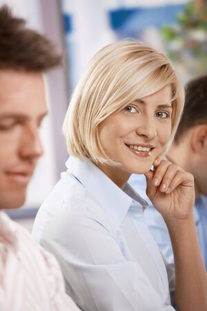 Happy businesswoman on business meeting looking at camera and smiling. Stock Photo - 6373615