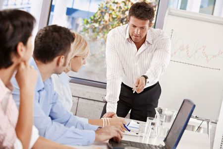 present presentation: Businessman doing business presentation in meeting room.