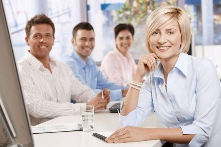 Happy businesswoman on business meeting at office, leaning on table, looking at camera and smiling. Stock Photo - 6373673