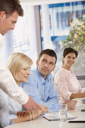 leading light: Young businesspeople having business meeting in office boss explaining giving instructions. Stock Photo