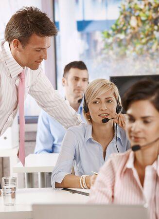 Helpdesk operators working in team in office. Stock Photo - 6374095