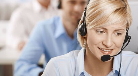 Portrait of young customer service operator talking on headset, smiling. Stock Photo - 6374196