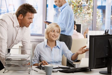 Business people working together in office, using persnal organizer and desktop computer. Stock Photo - 6374190