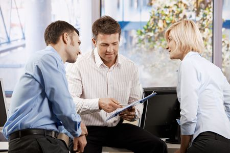 Business team working in office, people talking smiling. photo