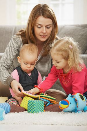 Mum playing on floor with two children at home. Stock Photo - 6374444