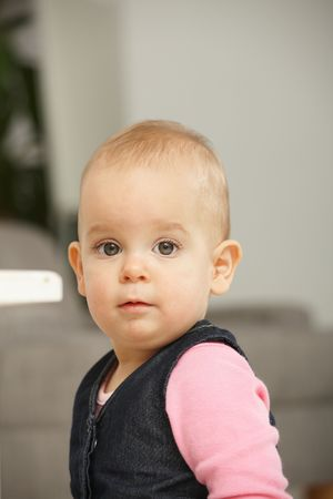 Portrait of cute baby girl looking at camera. Stock Photo - 6374420