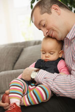 Cute little baby and father sleeping togehter at home. Stock Photo - 6374496