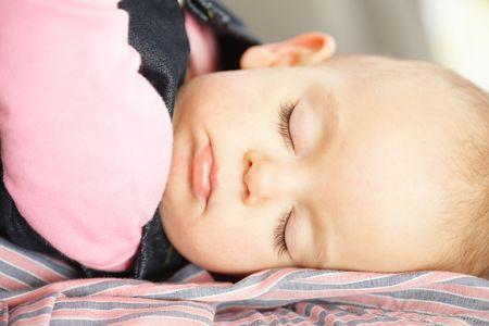 Cute baby girl fast asleep in closeup. Stock Photo - 6374414