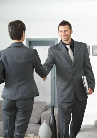 Business meeting at office lobby partners shaking hands. Stock Photo - 6432785