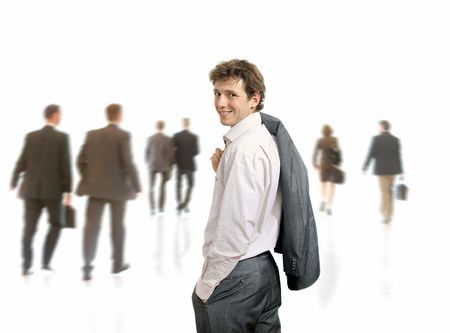 undoubting: Young businessman standing his suit draped over his shoulder, looking back. Businesspeople moving in the background, isolated on white.