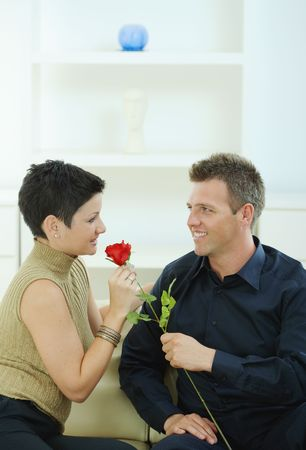 Romantic man giving red rose to woman for Valentine's Day. Stock Photo - 6463523