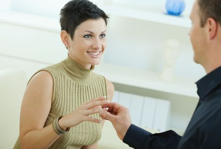 Man making a proposal giving engagement ring to her fiencee. Stock Photo - 6463502