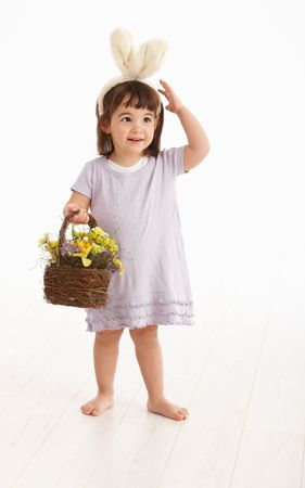 3 year old: Little two years old girl wearing Easter bunny ears, isolated on white background.