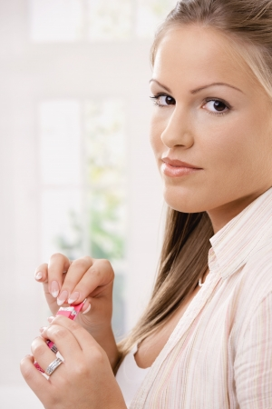 Closeup portrait of beautiful young woman holding chewing gums in her hand. Stock Photo - 6473206