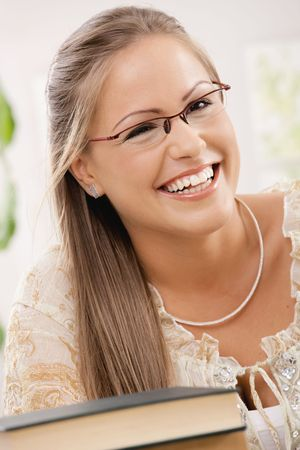 Closeup portrait of happy student girl, wearing glasses, smiling. photo