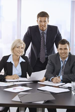 Portrait of team of business professionals in skyscraper office. Stock Photo - 6508235