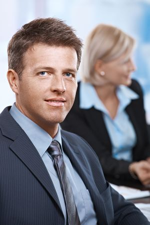 Portrait of smiling businessman looking at camera office.