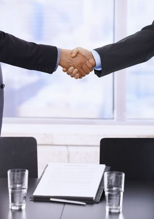 Business handshake in closeup over signed contract. Stock Photo - 6508229