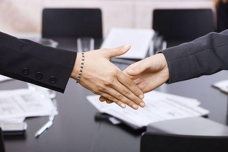 Closeup of hands. Businesswomen handshake over table, in office meeting room. Stock Photo - 6508192