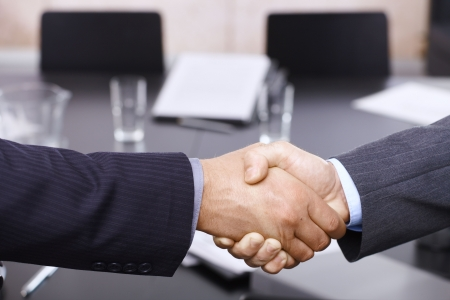 Closeup of hands. Businessmen handshake over table, in office meeting room. photo