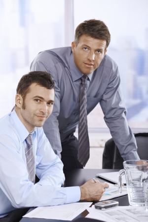 Portrait of confident businessmen at work in skyscraper office. Stock Photo