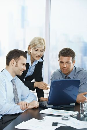 co worker: Happy business people talking on meeting at office, smiling, Stock Photo