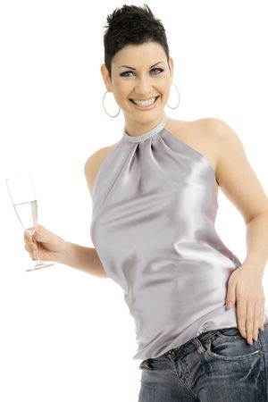 adult only: Happy young woman dressed for party holding a glass of champagne, smiling. Isolated on white background. Stock Photo