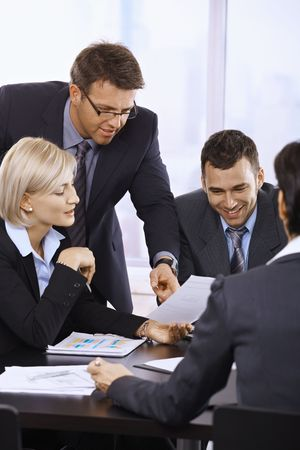corporation: Business people working together at meeting table in office.