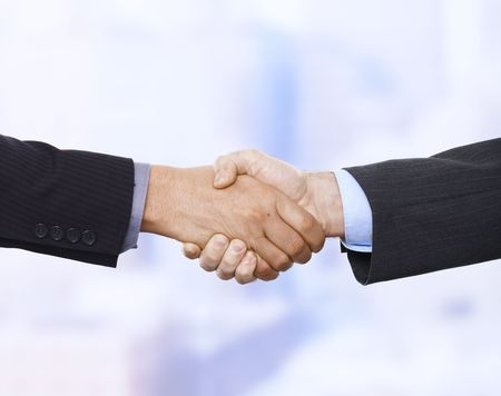 situation: Handshake in closeup in business situation in office. Stock Photo