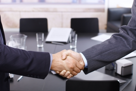 shake hands: Handshake in closeup, business meeting in office.