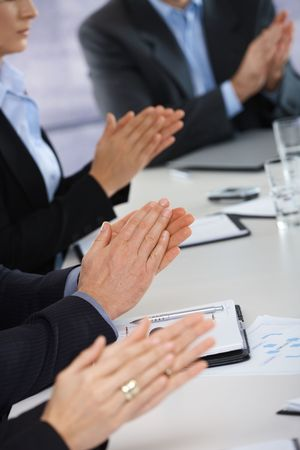 Closeup of hands on business meeting at office clapping photo