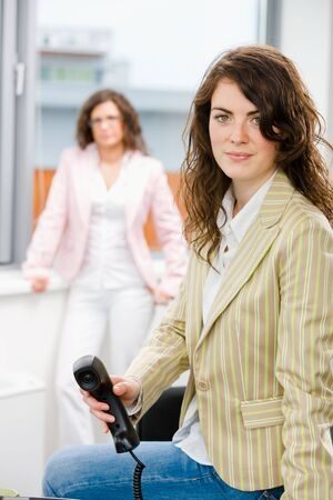 Businesswomen at office, business woman calling on phone. photo