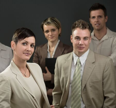 Businesswoman standing in front of his smiling team. photo