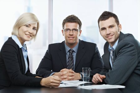 Portrait of businesspeople at office meeting looking at camera sitting at table. Stock Photo - 6578819