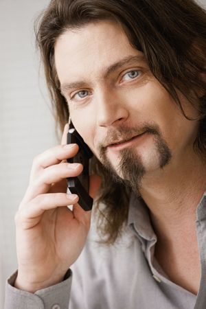 Closeup portrait of man talking on mobile phone. Stock Photo - 6583019