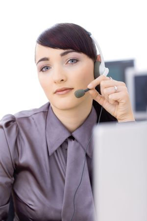 Young female customer service operator talking on headset, holding the microphone. Stock Photo - 6593012