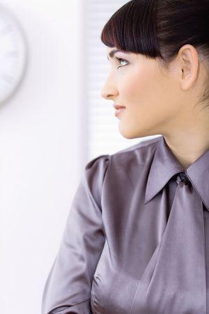 Profile portrait of beautiful young businesswoman. photo