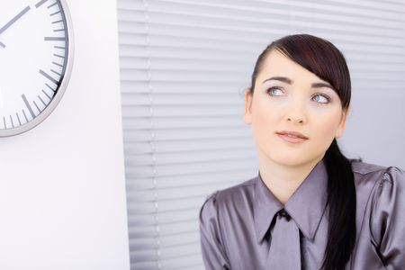 Closeup portrait of attractive young businesswoman, looking left, smiling. Stock Photo - 6597247