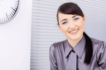 Closeup portrait of happyyoung businesswoman, looking at camera, smiling. photo