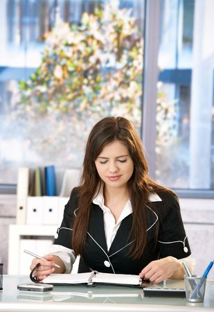 Young woman working at office table. photo