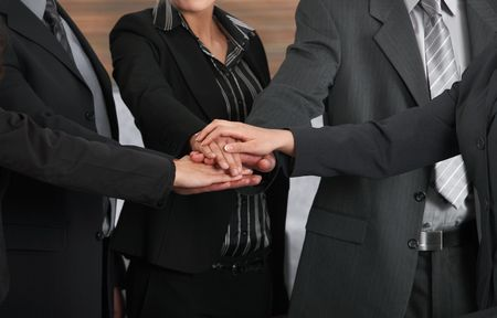 Closeup photo of joined hands of business team. photo