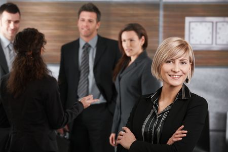 Portrait of young businesswoman having career as part of successful business team. Stock Photo - 6711849